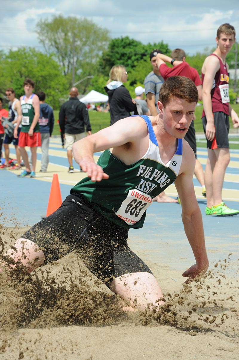 Cormac Brown of St. Patrick's sends up a spray of sand in long jump at the SWOSSA track and field championships at the University of Windsor. Brown nailed a jump of 6 metres and 84 centimetres to win the senior boys event and advance to the Ontario regionals. Sharon O'Brien Photo