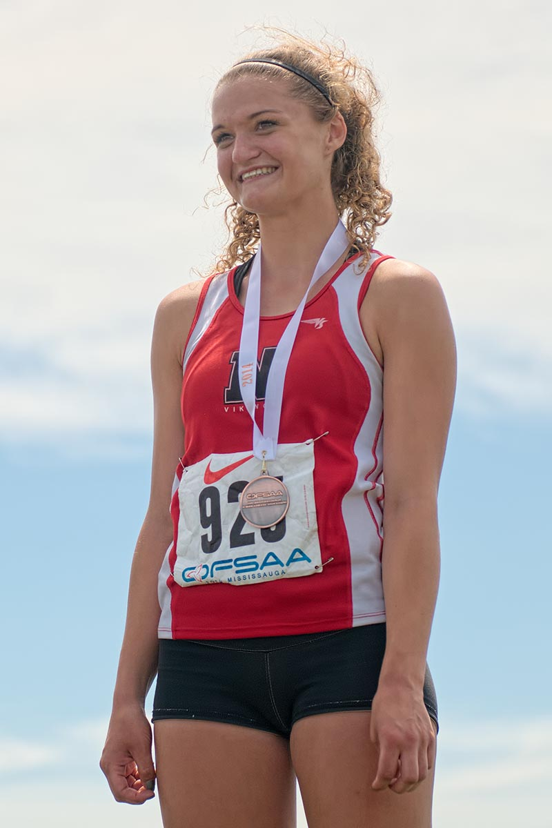 Kelly Hodgins of Northern Collegiate proudly wears the bronze she won in 80 metre hurdles. Bruce Smith Photo
