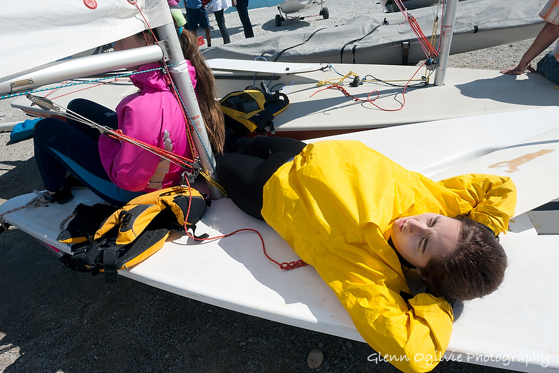 Jillian Smith, 14, and Elayna Hurst, 17, of the London Yacht Club, keep warm and rest up while waiting for the wind to rise at Sailfest Sarnia. Glenn Ogilvie