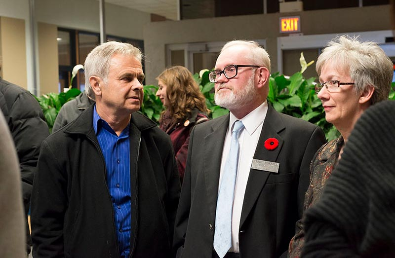 Andy Bruziewicz, left, who kept his seat on Sarnia council Monday has a quiet word in the lobby of city hall with long-serving incumbent Terry Burrell, who did not. Glenn Ogilvie