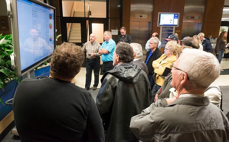A small crowd watches the election results roll in Monday night at Sarnia city hall. Glenn Ogilvie