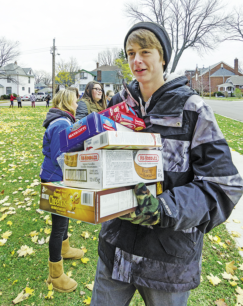 SCITS student Zack Roehler has his arms full of cereal and pasta destinated for the Inn. Glenn Ogilvie