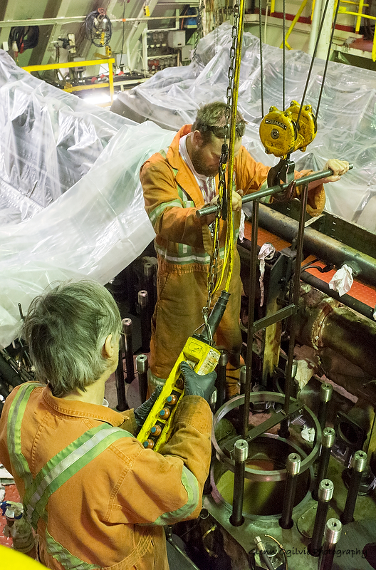 Algoma Central's Don Reashore, left, and Mark Lunn work on an engine piston deep in the bowels of the Algoma Olympic, a Canadian cargo carrier. Glenn Ogilvie