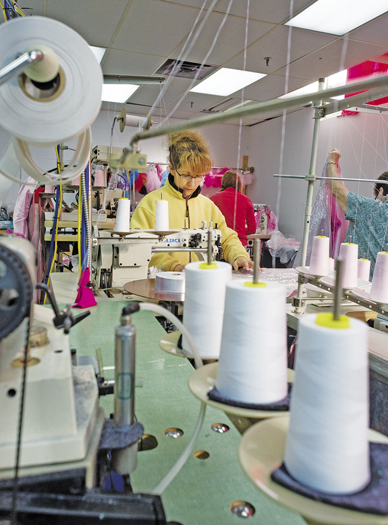 Seamstress Maria Moniz stitches a costume on the line at Great Pretenders manufacturing centre in Point Edward. Glenn Ogilvie