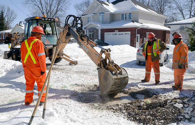 A City of Sarnia public works crew contends with a frozen water main. From left are Will Marut, James Smith and Roger Chedore. In the backhoe is Jeremy Hull. Glenn Ogilvie