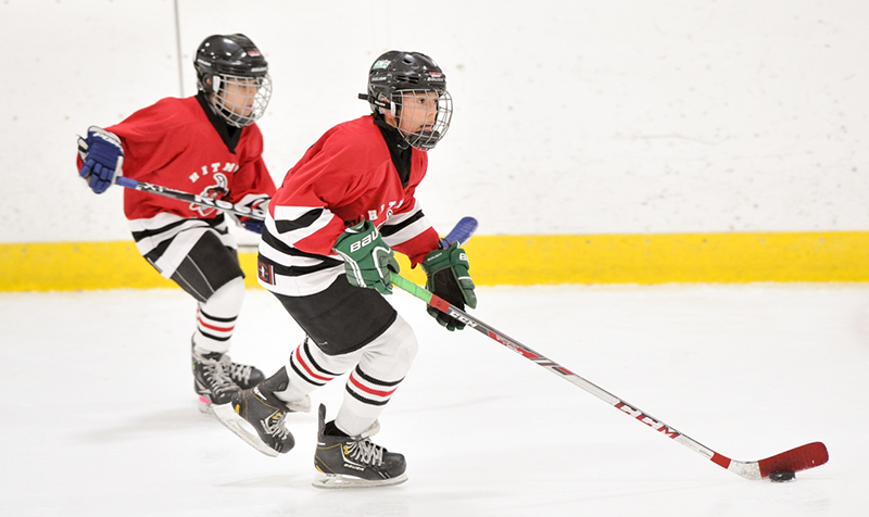 Stanley MacDonald of the Aamjiwnaang Jr. Hitmen leads the rush with teammate Tyler Andre trailing during the Atom A championship final of the Little Native Hockey League tournament in Mississauga, the largest in Canada. Submitted Photo