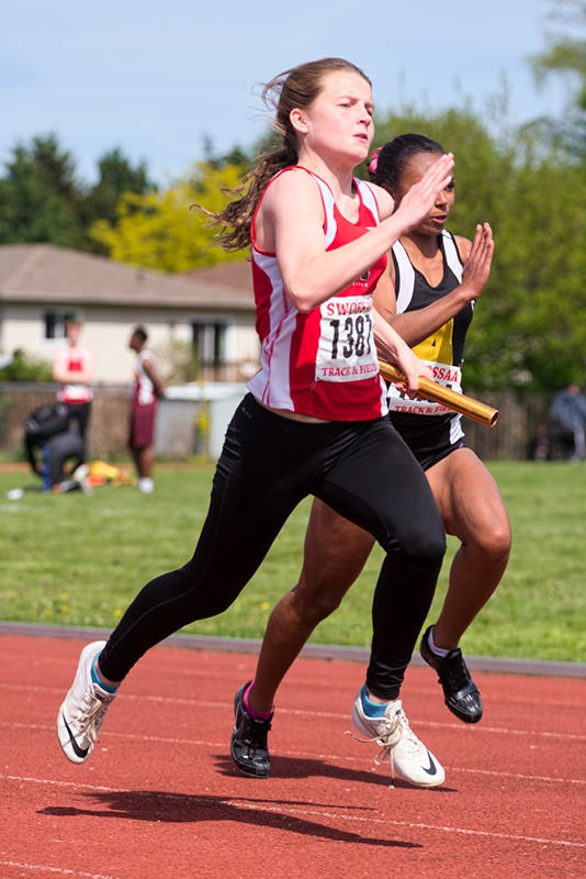 Skyla Minaker carries the baton for Northern Collegiate at the SWOSSA track and field meet, held last weekend at Chatham-Kent and Windsor. She and teammates Georgia Auger, Kristy Hodgins and Kelly Hodgins placed first in the senior girl's 4x100 metre relay with a time of 49.26. Competing as a junior, Minaker won the 80-metre hurdles, was second in long jump and fourth in triple-jump. Top five finishers in each event advanced to the all-Ontario meet in London May 29-30. Bruce Smith, Special to The Journal
