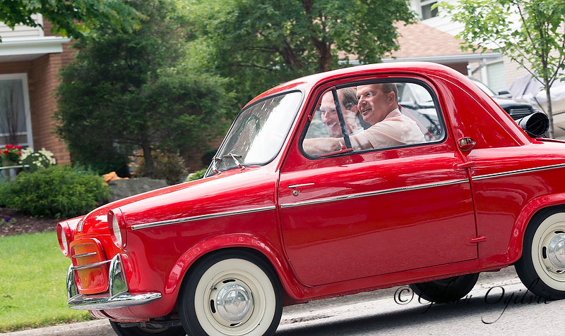 The 1958 Vespa is a car that easily fits in the back of the Poores' pickup truck. Glenn Ogilvie