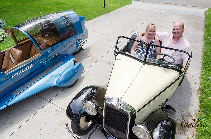 Kenn and Donna Poore pose for a photo in their 1932 American Austin Roadster. Glenn Ogilvie