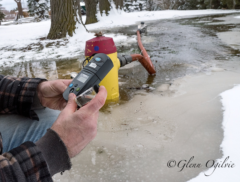 City of Sarnia worker Alex Scheibner flushes a fire hydrant while testing the water for chlorine. Glenn Ogilvie