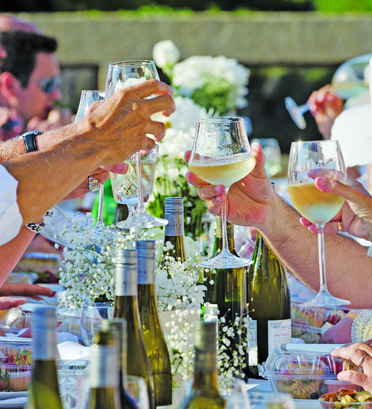 Diners raise a toast during Sarnia's first Simply White Dinner, which was held on the patio of a downtown waterfront highrise. Glenn Ogilvie file photo
