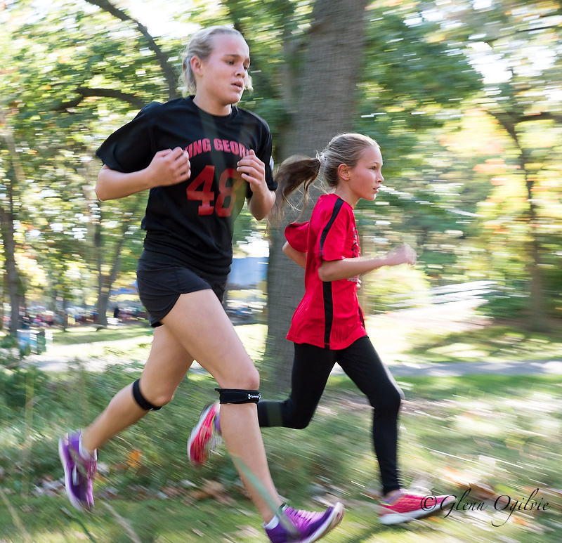 Morgan Hughes, of King George VI, left, and Alaina Burns, of Bridgeview, compete in Canatara Park. Glenn Ogilvie     Hundreds of highly spirited elementary school kids converged at Canatara Park for the annual cross country meet.