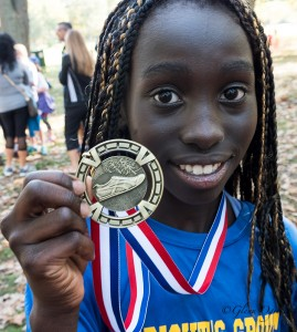 Ann Mabel Wambulwa, of Bright's Grove Public, shows off her third place medal in the 11-year-old division. Glenn Ogilvie