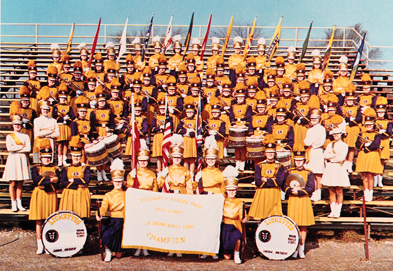 The Lionettes junior drum and bugle corp pose with a championship banner at Norm Perry Park. Submitted Photo