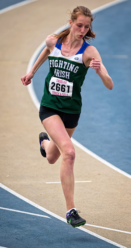 Paige Vrolyk of St. Patrick's High School won both the junior girls triple jump and long jump at the South Western Ontario Secondary School Athletic Association track and field championships. Here, she competes in the 200m dash, in which she finished third. Bruce Smith, Special to The Journal